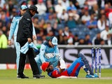 Afghanistan's Hashmatullah Shahidi is floored by a bouncer against England on June 18, 2019