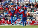 Afghanistan's Mujeeb Ur Rahman celebrates taking the wicket of India's Rohit Sharma on June 22, 2019