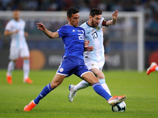Argentina's Lionel Messi battles Paraguay's Matias Rojas for the ball in the Copa America on June 19, 2019