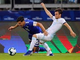 Argentina's Nicolas Tagliafico challenges Paraguay's Gustavo Gomez for the ball in the Copa America on June 19, 2019