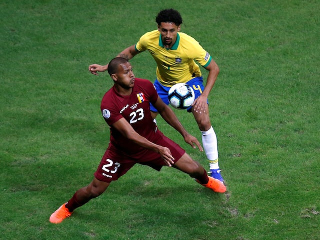 Brazil's Marquinhos in action with Venezuela's Salomon Rondon at the Copa America on June 18, 2019