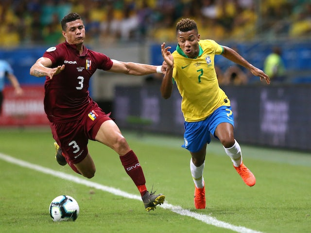 Brazil's David Neres in action with Venezuela's Yordan Osorio at the Copa America on June 18, 2019