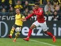 Mainz's Jean-Philippe Gbamin in action with Borussia Dortmund's Mario Gotze in the Bundesliga on April 13, 2019