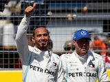 Mercedes' Lewis Hamilton celebrates pole after qualifying with second place Mercedes' Valtteri Bottas on June 22, 2019