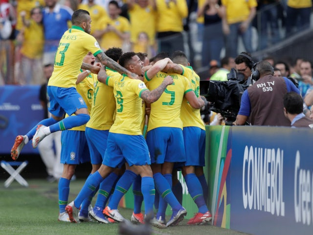 Brazil's players celebrate after Casemiro opens the scoring against Peru in their Copa America clash on June 22, 2019
