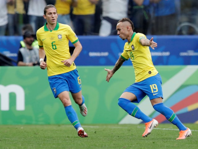Everton celebrates scoring Brazil's third goal against Peru in the Copa America group clash on June 22, 2019