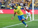 Dani Alves celebrates after putting Brazil four goals in front against Peru in their Copa America clash on June 22, 2019