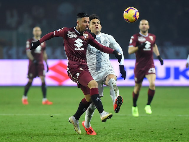 Torino defender Armando Izzo in action with Inter Milan striker Lautaro Martinez in Serie A on January 27, 2019