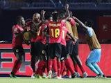 Angola's Djalma celebrates scoring their first goal with teammates against Tunisia on June 24, 2019