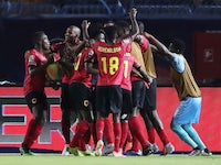 Angola's Djalma celebrates scoring their first goal with teammates against Tunisia on June 24, 2019