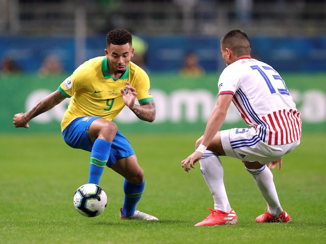 Brazil's Gabriel Jesus in action with Paraguay's Junior Alonso in the quarter-finals of the Copa America on June 27, 2019
