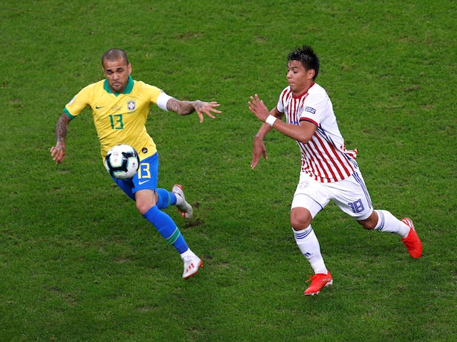 Brazil's Dani Alves in action with Paraguay's Santiago Arzamendia in the quarter-finals of the Copa America on June 27, 2019