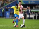 Brazil's Roberto Firmino in action with Paraguay's Fabian Balbuena in the quarter-finals of the Copa America on June 27, 2019