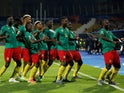 Cameroon's Stephane Bahoken celebrates scoring their second goal against Guinea-Bissau with teammates on June 25, 2019