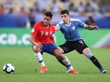 Chile's Alexis Sanchez in action with Uruguay's Giovanni Gonzalez at the Copa America on June 24, 2019