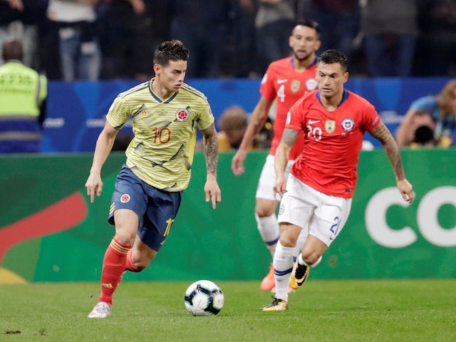 Colombia's James Rodriguez in action with Chile's Charles Aranguiz in the Copa America quarter-finals on June 28, 2019