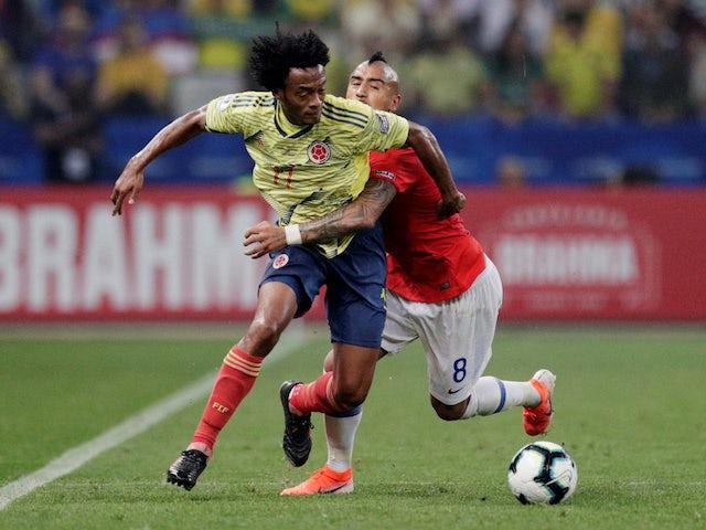 Colombia's Juan Cuadrado in action with Chile's Arturo Vidal in the Copa America quarter-finals on June 28, 2019