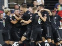 DC United forward Wayne Rooney (9) celebrates with teammates after scoring a goal from beyond midfield against Orlando City SC in the first half at Audi Field on June 27, 2019