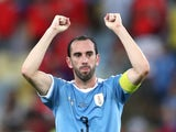 Uruguay captain Diego Godin celebrates his team's win over Chile at the Copa America on June 24, 2019
