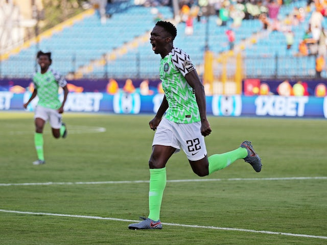 Nigeria's Kenneth Omeruo celebrates scoring against Guinea on June 26, 2019