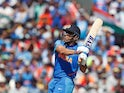 India's MS Dhoni hits a six against West Indies on June 27, 2019