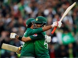 Pakistan's Babar Azam and Sarfaraz Ahmed celebrate after winning the match against New Zealand on June 26, 2019