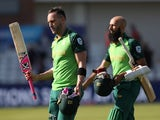 South Africa's Faf du Plessis and Hashim Amla walk off after winning the match against Sri Lanka on June 28, 2019