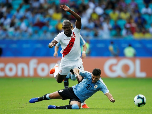 Uruguay's Giorgian de Arrascaeta in action with Peru's Luis Advincula in their Copa America quarter-final clash on June 29, 2019