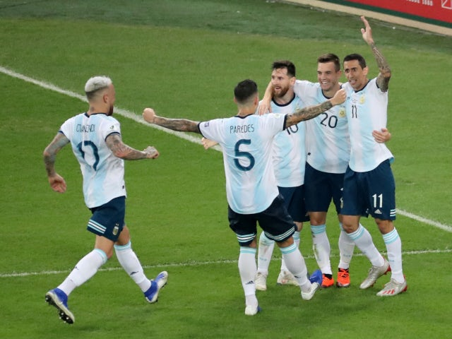 Giovani Lo Celso is congratulated by his Argentina teammates after scoring his side's second goal against Venezuela on June 28, 2019