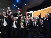 Delegation members representing Milan Cortina celebrate after the city won the bid to host the 2026 Winter Olympic Games during the 134th Session of the International Olympic Committee (IOC), at the SwissTech Convention Centre, in Lausanne, Switzerland Ju