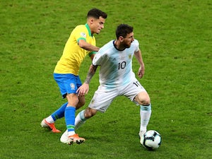Argentina's Lionel Messi in action with Brazil's Philippe Coutinho during the Copa America semi-final on July 2, 2019