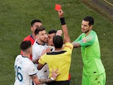 Chile's Gary Medel and Argentina's Lionel Messi are shown a red card by referee Mario Diaz de Vivar on July 6, 2019