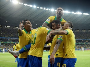 Brazil's Gabriel Jesus celebrates scoring their first goal against Argentina with teammates on July 3, 2019