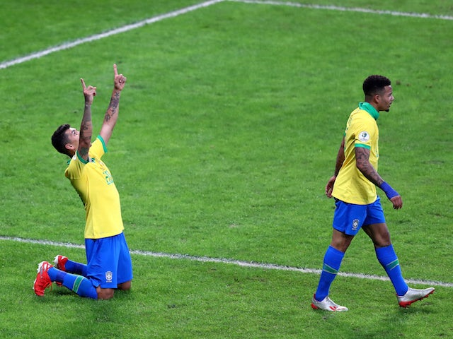 Brazil's Roberto Firmino celebrates scoring their second goal with Gabriel Jesus on July 3, 2019