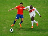 Chile's Alexis Sanchez in action with Peru's Luis Advincula in the Copa America semi-finals on July 3, 2019