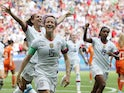 Megan Rapinoe of the U.S. celebrates with team mates after scoring their first goal on July 7, 2019
