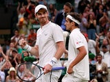 Britain's Andy Murray and France's Pierre-Hugues Herbert celebrate after winning their first round double's match against Romania's Marius Copil and France's Ugo Humbert on July 4, 2019