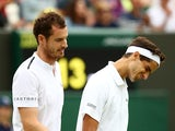Britain's Andy Murray and France's Pierre-Hugues Herbert look dejected after losing their second round double's match against Croatia's Franko Skugor and Nikola Mektic on July 6, 2019