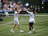 Britain's Andy Murray celebrates winning his first round mixed doubles match with Serena Williams of the U.S. against Chile's Alexa Guarachi and Germany's Andreas Mies on July 6, 2019