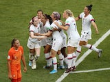 Rose Lavelle of the U.S. celebrates scoring their second goal with team mates on July 7, 2019