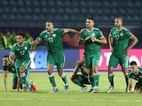 Algeria players celebrate winning the penalty shootout against Ivory Coast on July 11, 2019