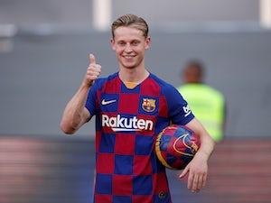 Barca midfielder De Jong vows to improve