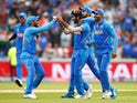 India's Jasprit Bumrah celebrates taking the wicket of New Zealand's Martin Guptill on July 9, 2019
