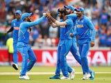 India's Jasprit Bumrah celebrates taking the wicket of New Zealand's Martin Guptill on July 9, 2019