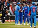 India's Yuzvendra Chahal celebrates taking the wicket of New Zealand's Kane Williamson with teammates on July 9, 2019