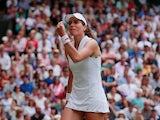 Britain's Johanna Konta reacts during her quarter final match against Czech Republic's Barbora Strycova on July 9, 2019