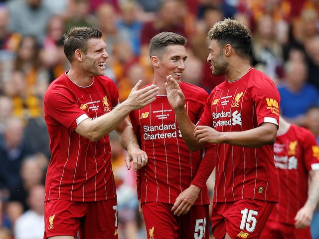 Liverpool's James Milner celebrates scoring their first goal with Harry Wilson and Alex Oxlade-Chamberlain on July 14, 2019