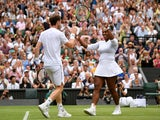 Britain's Andy Murray and Serena Williams of the U.S. celebrate winning their second round mixed doubles match against France's Fabrice Martin and Raquel Atawo of the U.S on July 9, 2019