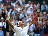 Switzerland's Roger Federer celebrates after winning his semi-final match against Spain's Rafael Nadal on July 12, 2019