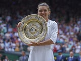 Simona Halep celebrates winning Wimbledon on July 13, 2019